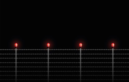 barbed wire fence with red flashing lights