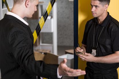 officer interviewing man