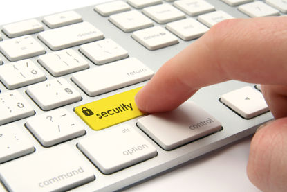 hand pressing security button on a keyboard